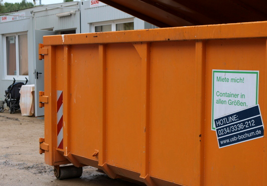 "The sign on this orange container in the Lager reads ""containers in all sizes"" – they seem to have taken this literally. And containers for everything, one might add, for garbage, people…"